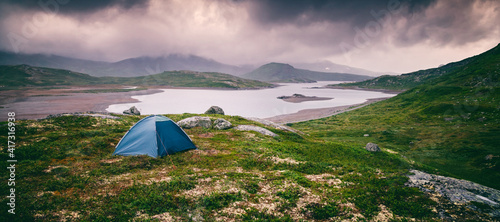 Leinwand Poster Wild camping with a tent in northern Europe traveling in Scandinavia, a national