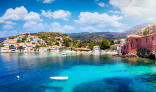 The Beautiful Fishing Village Of Assos On The Ionian Island Of Cephalonia, Greece, With Emerald Sea And Colorful, Red Roofed Houses Along The Hills