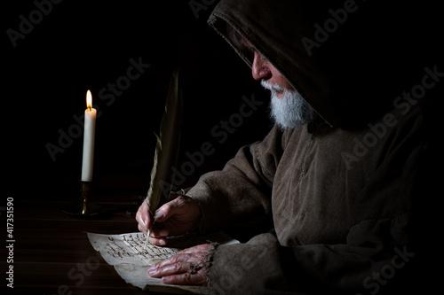 Valokuva Medieval monk writes a letter