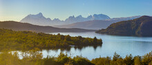 Panoramic View Of A Landscape With Mountains And Lake In Late Afternoon Light