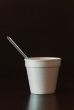 Disposable Foam Cup With A Stir Stick On A Black Background