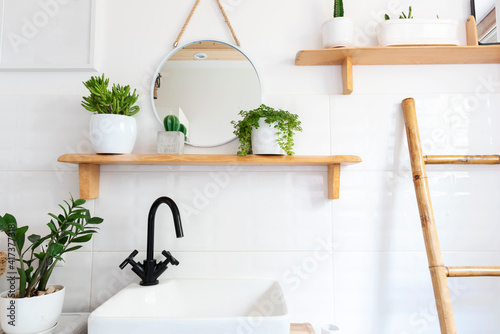 Rustic bathroom with white tiles and wooden shelf and ladder as a decor Fototapeta