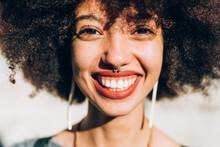 Close Up Of Young Woman Smiling, Looking At Camera