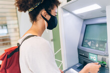Young Woman Wearing Face Mask, Using ATM