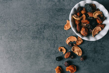 Dried Fruits On A White Plate. Assortment Dried Fruits Close Up. Dried Fruits, Apples, Pears, Apricots, Plums, Grapes