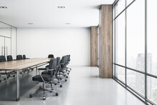 Light Spacious Meeting Room With Wooden Conference Table, Black Chairs Around, Glossy Floor And Big Window