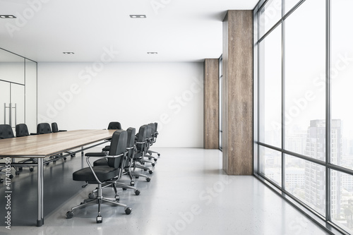 Obraz Light spacious meeting room with wooden conference table, black chairs around, glossy floor and big window - fototapety do salonu