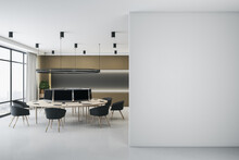 Light Blank Wall In Coworking Office For Teamwork With Eco Style Furniture, Big Window And Black Chairs. Mock Up