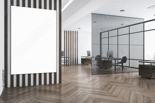 White poster with copyspace on striped wall in modern open space office with eco style interior, parquet and airy partition. Mockup