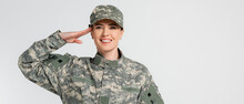 Cheerful Soldier Saluting And Looking At Camera Isolated On Grey, Banner