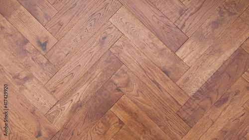 Fototapeta Full frame wood block background in herringbone pattern showing grain detail obraz na płótnie
