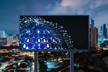 Glowing Social media icons on billboard over night panoramic city view of Kuala Lumpur, Malaysia, Asia. The concept of networking and establishing new connections between people and businesses in KL