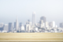 Blank Wooden Table Top With Beautiful Blurry Skyline At Daytime On Background, Mockup