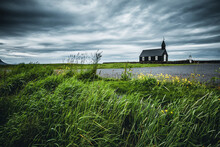Lonely Wooden Christian Church Budakirkja. Location Place Hamlet Of Budir, Snafellsnes Peninsula, Iceland, Europe.