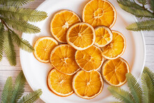 Plate Of Dried Oranges On A Table With Fir Branches For Christmas