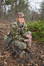 Female Turkey Hunter Wearing Camouflage Holding An Aluminum Slate Call