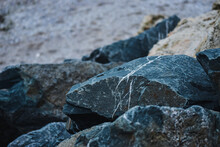 Closeup Shot Of Weathered Rock Formations By The Sea