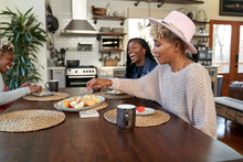 Black Girlfriends Talking And Eating At Table, Friends Togetherness