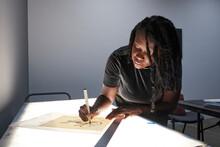 Black Female Artist Creative Drawing In Studio