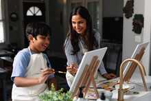 Indian Mother And Son Laughing, Painting At Home, Do-it-yourself