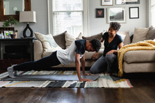 Black Mom Helps Son Do Exercises At Home, Stay Fit, Health And Wellness