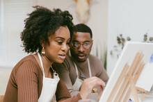 Man Watches Girlfriend Finish Painting, Date Night