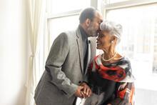 Senior Man Kisses Wife On Forehead, Loving Moments