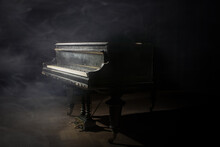 Old Grand Piano On The Dark Stage