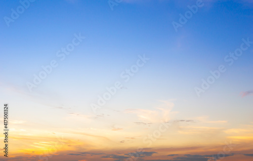 Fototapeta Beautiful sky painted by the sun leaving bright golden shades.Dense clouds in twilight sky in winter evening.Image of cloud sky on evening time.Evening sky scene with golden light from the setting sun obraz