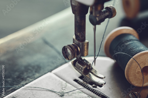 Fototapeta Close up of sewing needle
