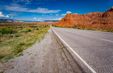 Flat Road Cuts Through The Desert Area Called Red Rocks Of Fire