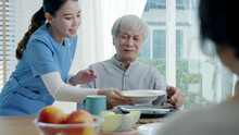 Attractive Young Senior Asian Citizen Couple Happy Sit, Talk, Eat Soup For Healthy Nutrition Breakfast Meal On Dining Table At Home In Morning In Routine Lifestyle In Old Asia Nursing In-home Care.