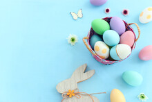 Cute Bunny Next To Easter Colorful Eggs Over Pastel Background
