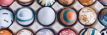 Topdown View Of Painted Easter Eggs Background, No People. Banner Frame.