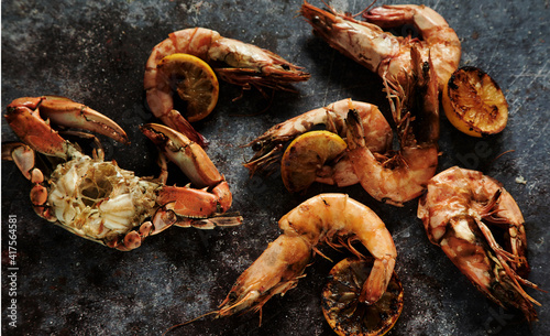 Fototapeta Appetizing prawns with crab and grilled lemon slices obraz
