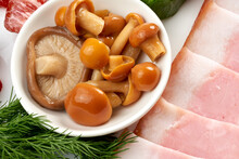 Pickled Mushrooms, Salted Honey Mushrooms Close-up On A Plate With Ham.