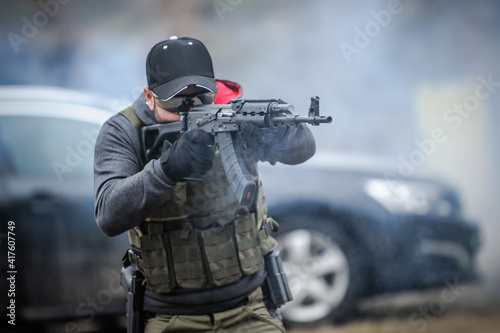 Fotografie, Obraz Military army soldier in action tactical combat shooting from rifle machine gun