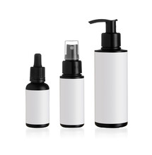 Set Of 3 Black Bottles With White Labels