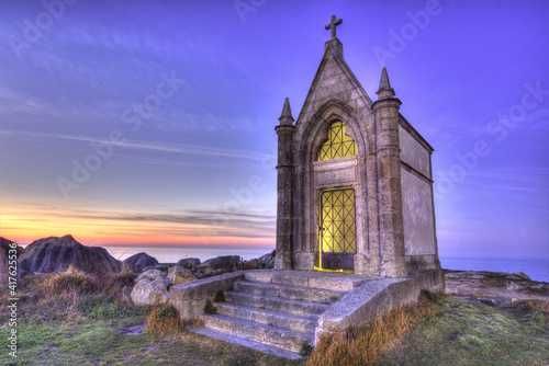 Night photography in hdr of a small hermitage located in the sea