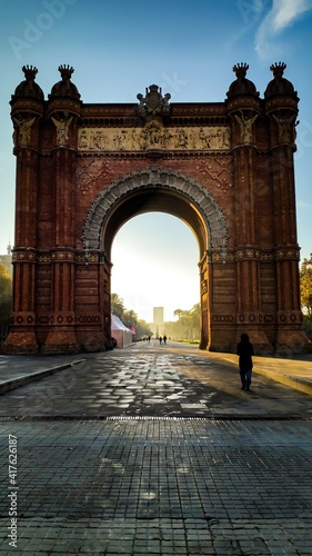 Barcelona, Spain, June 11, 2020: Arc de Triomf or Arco de Triunfo is triumphal arch in Barcelona city historical centre, clear blue sky in sunny day background, Catalonia, Spain. Sunset Barcelona.