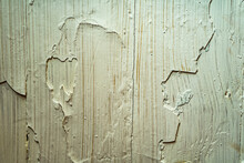 Old Paint In Several Layers. Old White Oil Paint Falls Off In Chunks From The Surface. The Problem With Incorrect Application Of Paint And Painting
