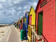 Colorful Beach Huts On A Cloudy Day At St James Beach In Cape Town