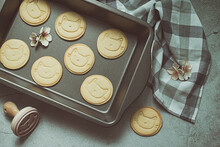 Overhead View Of Home Made Cookies With Cat Faces On A Baking Tray