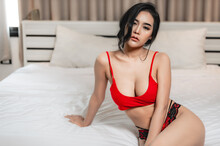 Portrait Of Asian Sexy Woman In The Bedroom