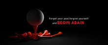 Begin Again And Start Again Concept.Close Up White Golf Ball On A Black Background.Golf Ball On Red Tee On Dark Background.copy Space And Panoramic Banner.