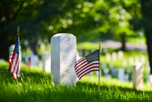 Headstones And National Flags In Arlington National Cemetery - Circa Washington D.C. United States Of America