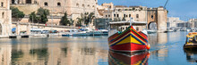 Traditionally Painted Passenger Boat In Vittoriosa