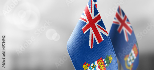 Obraz na plátne Patch of the national flag of the Cayman Islands on a white t-shirt