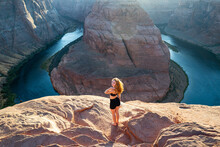 Woman On Grand Canyon. Travel And Active Lifestyle. Girl Enjoying View Of Horseshoe Bend.