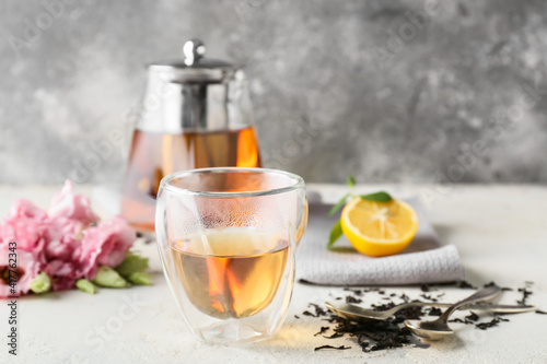 Glass of hot tea on table © Pixel-Shot